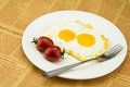 Nutritious breakfast tomatoes two egg fried egg very delicious food Royalty Free Stock Images