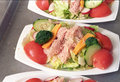 A nutritious lunch school of tomatoes cucumbers tuna fish broccoli and cheese Stock Image