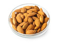 Nuts almonds in glass bowl isolated on white background Royalty Free Stock Photos