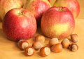 Nuts and apples Stock Photos