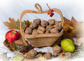 Nuts in a basket, apples and pears Royalty Free Stock Photo