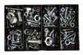 Nuts and bolts assorted in plastic box Stock Photography
