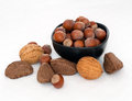 Nuts in bowl on white tablecloth hazelnuts brazils walnuts healthy food nut assortment Stock Photography