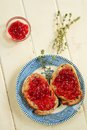 Nuts bread toast strawberry jam little container extra jam Royalty Free Stock Photo
