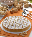 Nuts cake on a table and nuts cream. Stock Images