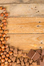 Nuts and candy displayed on a rustic wooden table Royalty Free Stock Image