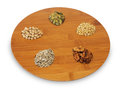 Nuts for diet on the wood plate Royalty Free Stock Photography