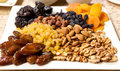 Nuts and dried fruits walnuts almonds hazelnuts various fruit Stock Photo