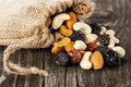Nuts and dried fruits on wooden background Stock Photos