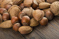 Nuts mix close up on the wood table Royalty Free Stock Photos