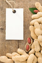 Nuts peanuts fruit and tag price on wood Stock Photo