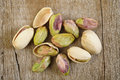 Nuts pistachios on wooden table background Stock Photos