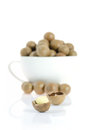 Nuts on white close up shelled macadamia background Stock Photos
