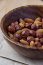 Nuts in wooden bowl Royalty Free Stock Images