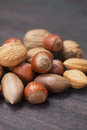 Nuts on a wooden surface heap of Royalty Free Stock Photography