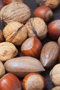 Nuts on a wooden surface heap of Royalty Free Stock Image