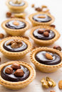 Nutty chocolate dessert small tarts on a white background Royalty Free Stock Photo