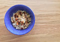 Nutty granola in blue bowl gourmet oat served with a wooden background Stock Images