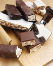 Nutty nougat in dark chocolate Stock Photography