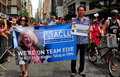 Nyc aclu members marching in gay pride parade marchers carrying a banner featuring edie windsor at the on s fifth avenue Royalty Free Stock Image