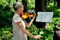 Nyc central park violinist a playing debussy s clair de lune at poet s walk on the mall in s Royalty Free Stock Images