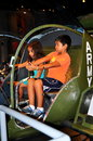 Nyc children at intrepid museum two young enjoy working the controls of a replica u s army plane during a visit the u s s sea air Royalty Free Stock Images