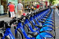 Nyc citibike bicycle docking station rows of the brand new rental bright blue bicycles emblazoned with the citibank logo sit at a Stock Image