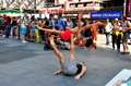 Nyc couple performing acrobatics in times square a skilled acrobatic duo perform for onlookers s busy near the tkts booth open Royalty Free Stock Photos