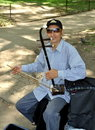 NYC: Musician Playing Chinese Erhu Royalty Free Stock Photo