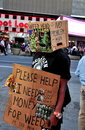 Nyc the no problem man in times square wearing a cardboard box over his head and carrying a sign requesting donations is one of Royalty Free Stock Photos
