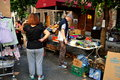 Nyc people browsing at a street fair for bargains displayed on outdoor tables combination yard sale sponsored by the west th Stock Images