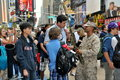 NYC: Soldier with Tourists in Times Square Stock Photography