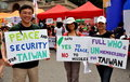 NYC: Taiwanese with Signs at Festival Royalty Free Stock Photography