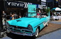 Nyc vintage plymouth convertible in times square a turquoise and white dual tone chrysler on display by the starz cable tv network Stock Photo