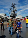 Nyc visitors at intrepid sea air space museum walking on the flight deck of the u s s moored on the hudson river in Stock Photo