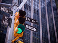 NYC Wall street yellow traffic green light black pointer guide O Royalty Free Stock Photo