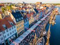 Nyhavn New Harbour canal and entertainment district in Copenhagen, Denmark. The canal harbours many historical wooden Royalty Free Stock Photo