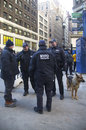 NYPD counter terrorism officers and NYPD transit bureau K-9 police officer with K-9 dog providing security on Broadway Stock Photos