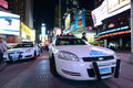 Nypd police car in times square at night manhattan new york city usa Royalty Free Stock Image