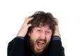 O homem com gritos e preensões de uma barba entrega a cabeça Imagem de Stock