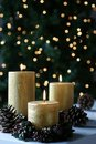 O ouro do Natal Candles luzes Fotografia de Stock Royalty Free