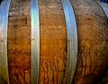 Oak barrel for fermenting beer steel metal hoops encircle used Stock Images