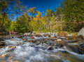 Oak creek sedona arizona in fall scenic near flows over boulders Royalty Free Stock Images