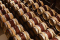 Oak wine barrels stacked in modern winery. View from above Royalty Free Stock Photo
