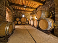 Oak wine barrels stacked in a winery cellar Stock Image