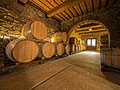 Oak wine barrels stacked in a winery cellar Royalty Free Stock Photos