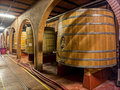 Oak wine barrels in a winery cellar Stock Photos
