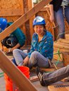Woman talks while working for Habitat For Humanity Royalty Free Stock Photo