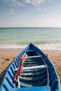 Oar boat on beach Royalty Free Stock Photo