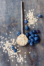 Oat flake healthy breakfast top view of and fresh berries over wooden background health and diet concept Stock Photography